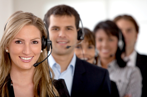 business customer support team in an office with headsets